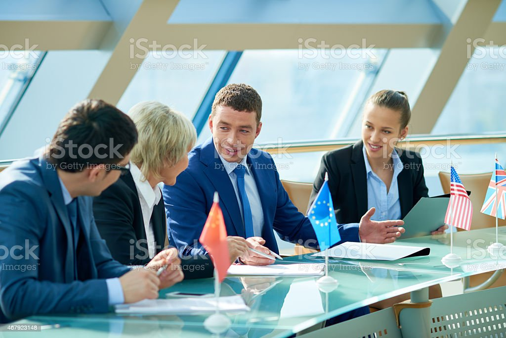 Discussion between representatives of different countries stock photo