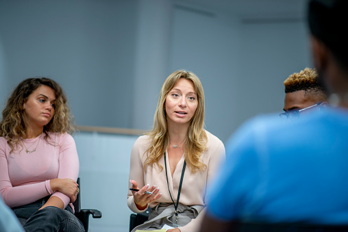 istock A Discussion During a Group Therapy Session About Mental Health and Addictions stock photo 1183477809