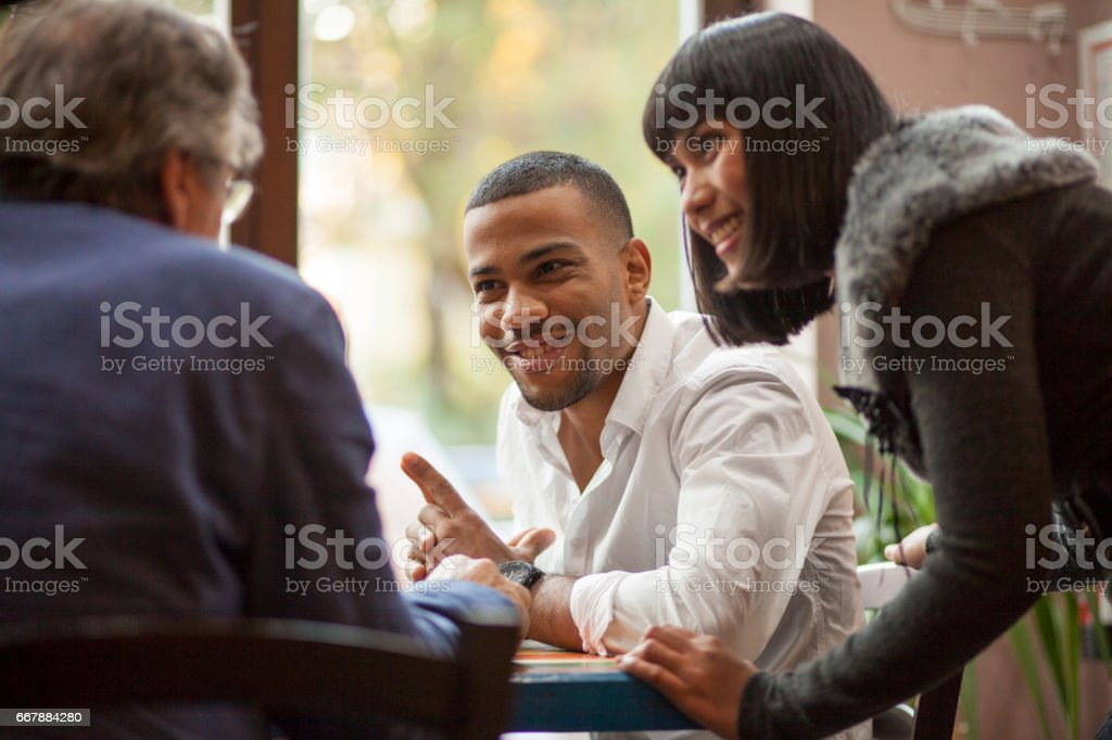 Discussion in coffe shop stock photo