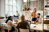 istock Discussion in start-up company between multi-ethnic employees 1180172391