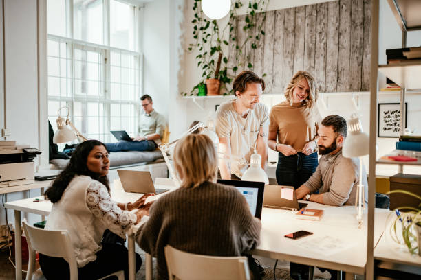 Discussion in start-up company between multi-ethnic employees stock photo