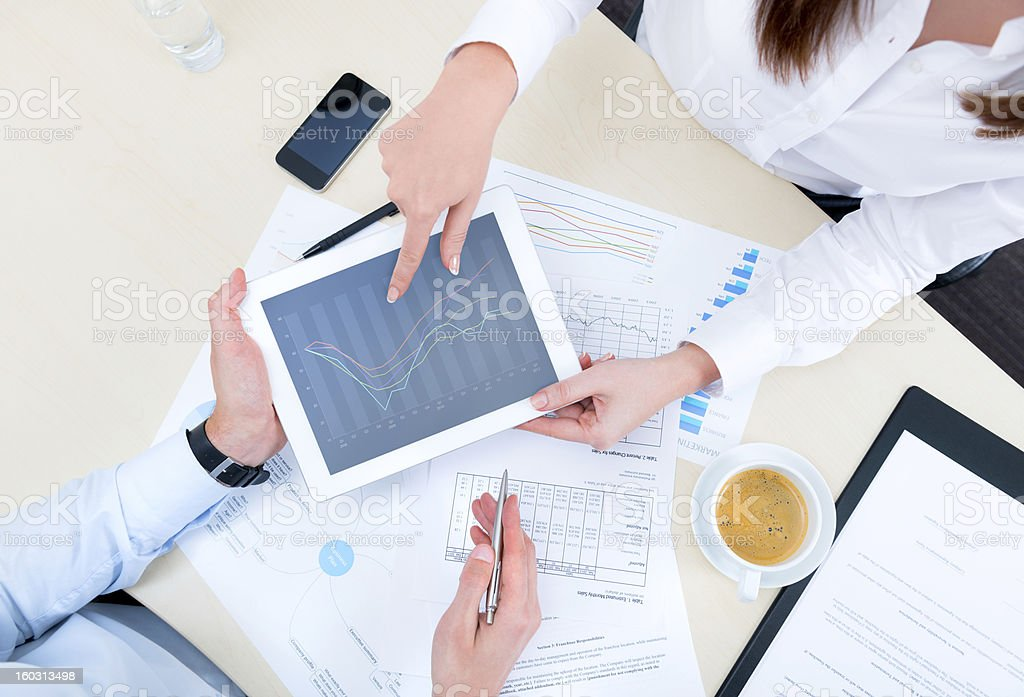 Discussion of strategy with a financial analyst stock photo