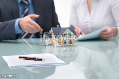 885968454istockphoto Discussion with a real estate agent 470740117