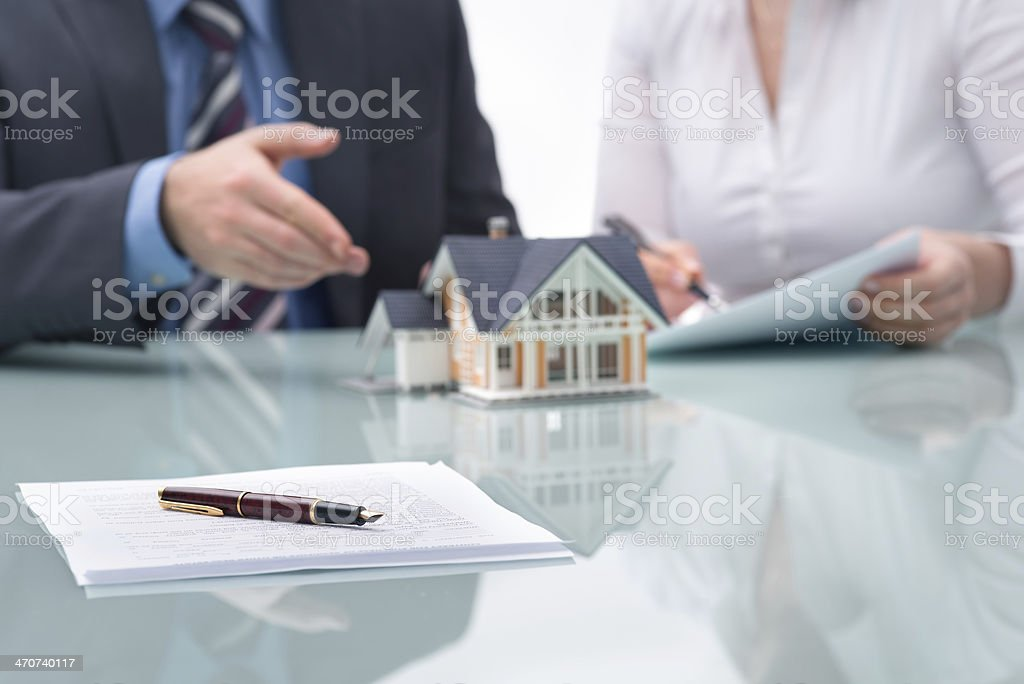Discussion with a real estate agent stock photo