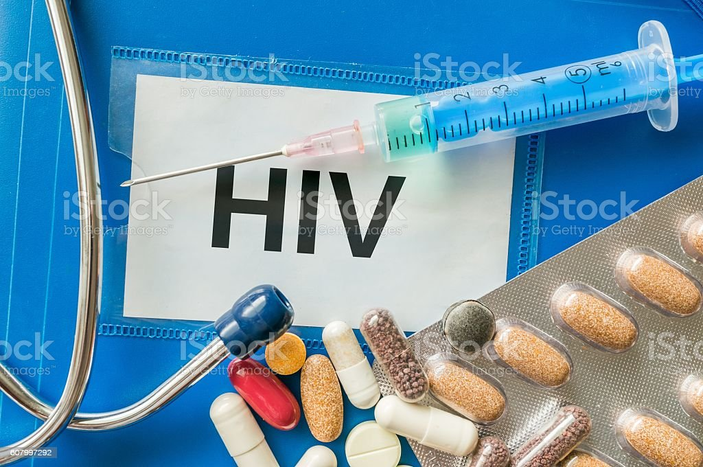 HIV disease concept. Many pills and drugs around. stock photo