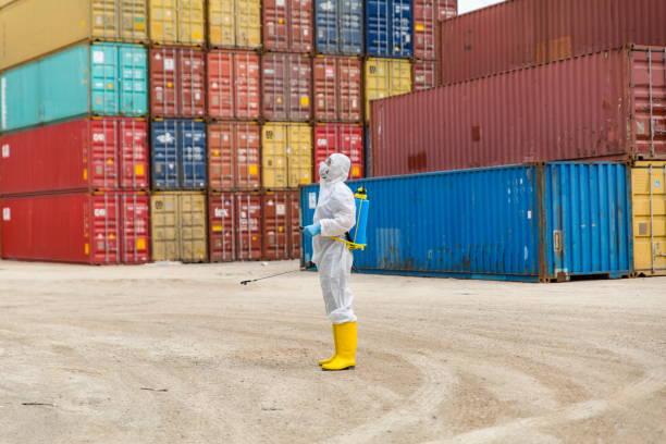 Disease control service Staff Disinfect Cargo To Prevent Spread COVID-19 stock photo
