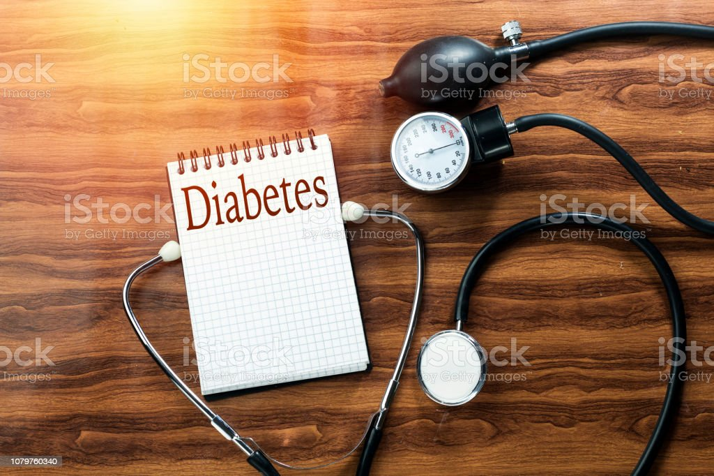 disease diabetes concept text writing on white notebook and black stethoscope,  sphygmomanometer on wood table disease diabetes concept text writing on white notebook and black stethoscope,  sphygmomanometer on wood table Algeria Stock Photo
