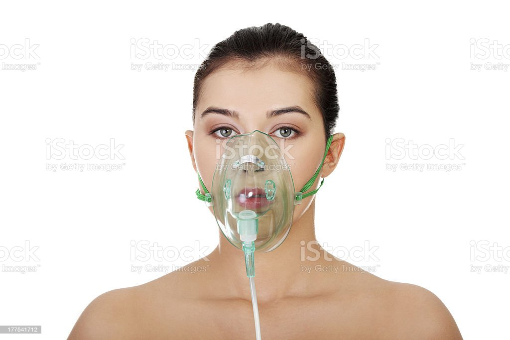 Diseased female patient wearing a oxygen mask stock photo