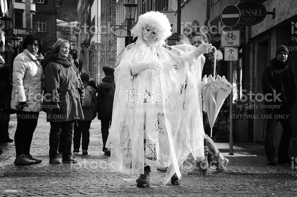 Disguised woman performing on the street stock photo