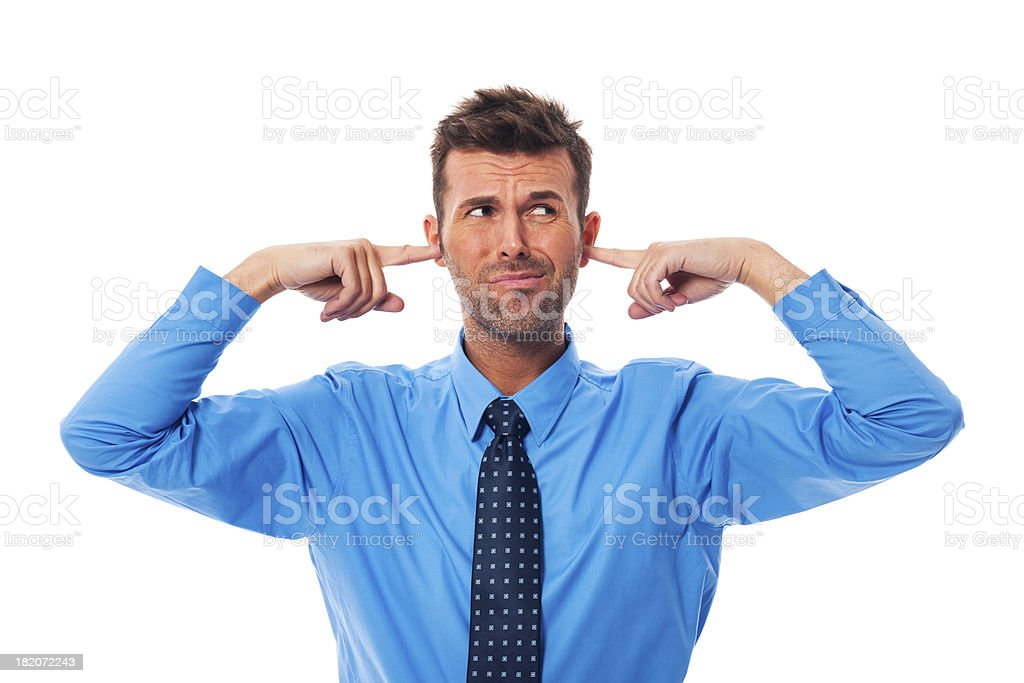 Disgust business man with fingers in ears stock photo