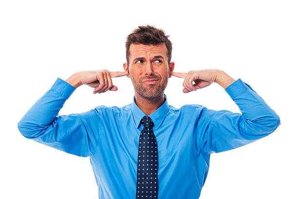 disgust business man with fingers in ears - covering ears stock photos and pictures