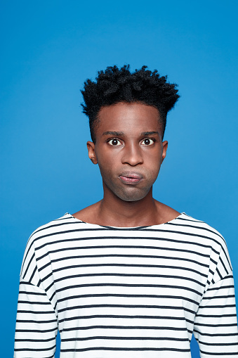 Disgusted Afro American Guy Stock Photo - Download Image Now