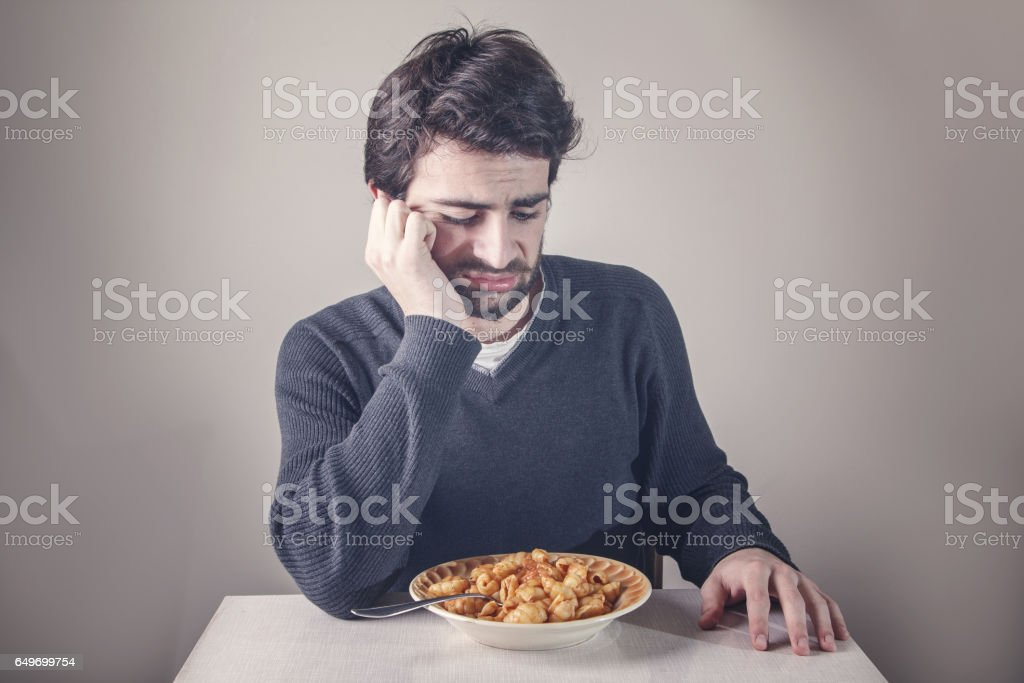 Disgusted man doesn't want to eat stock photo