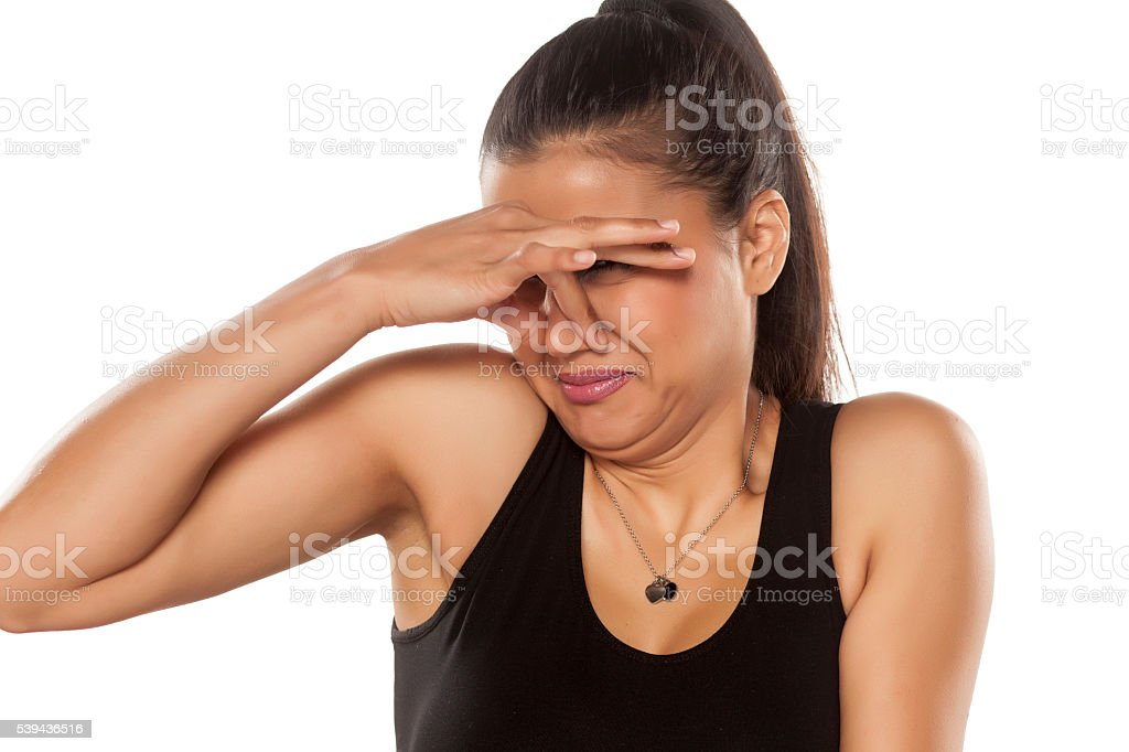 disgusted woman beautiful young dark skinned woman is disgusted by the smell Unpleasant Smell Stock Photo