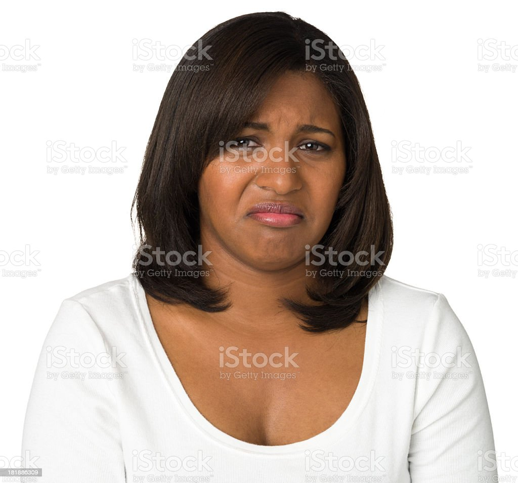 Disgusted Young Woman Looking At Camera stock photo