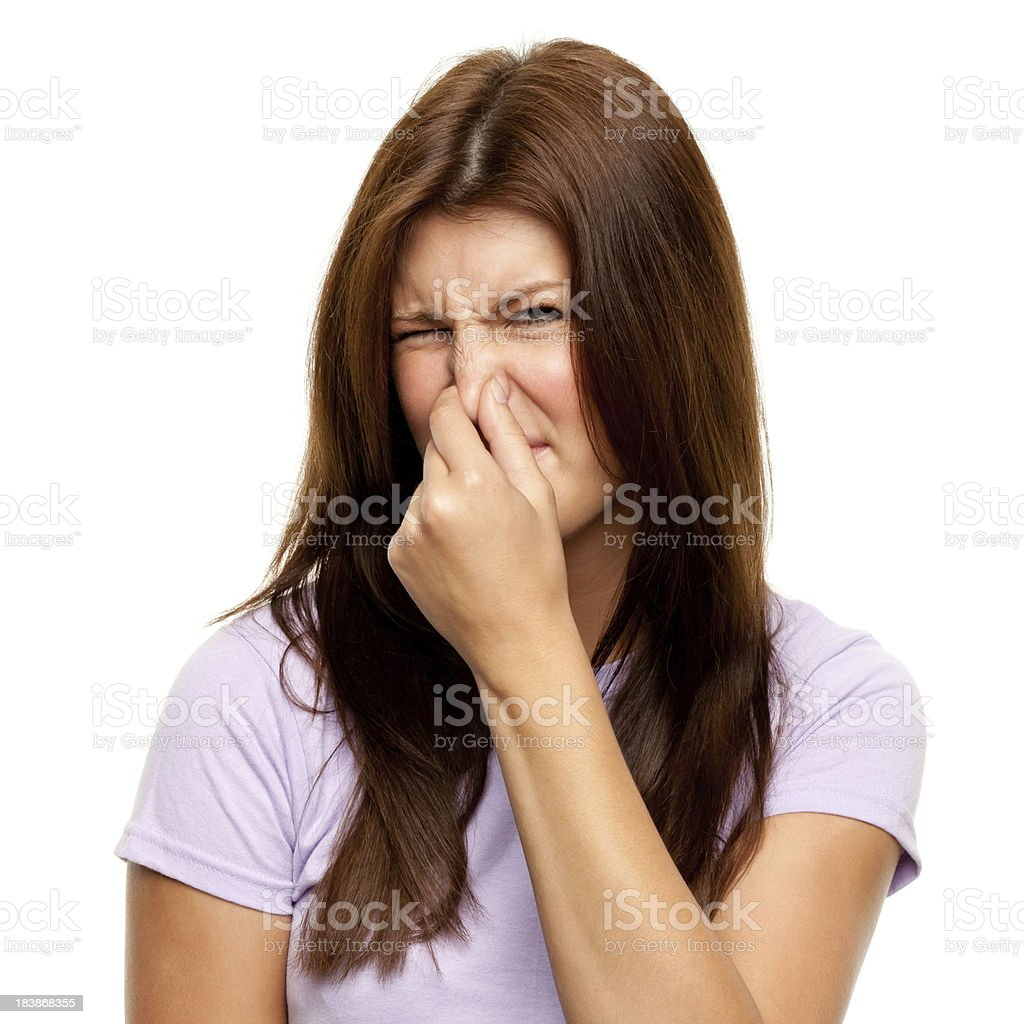 Disgusted Young Woman Pinching Nose stock photo