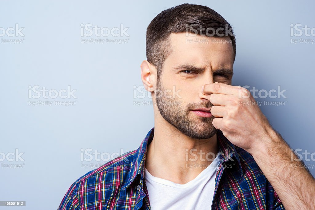 Disgusting smell. stock photo