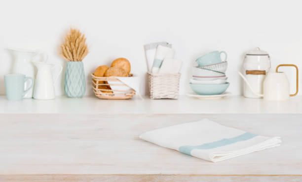 Dish cloth on wooden table over defocused kitchen counter background stock photo
