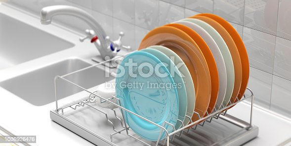 Dish drying rack with colorful clean plates on a white kitchen sink counter. 3d illustration