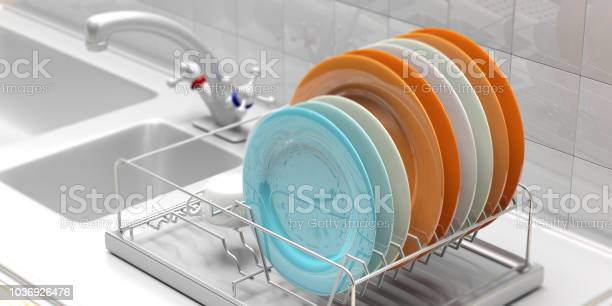 Dish drying rack with colorful plates on a white kitchen counter 3d picture id1036926476?b=1&k=6&m=1036926476&s=612x612&h=wtl4o xghc7v lw8o kdgxtsy4ucj n4ksnz88ceivw=