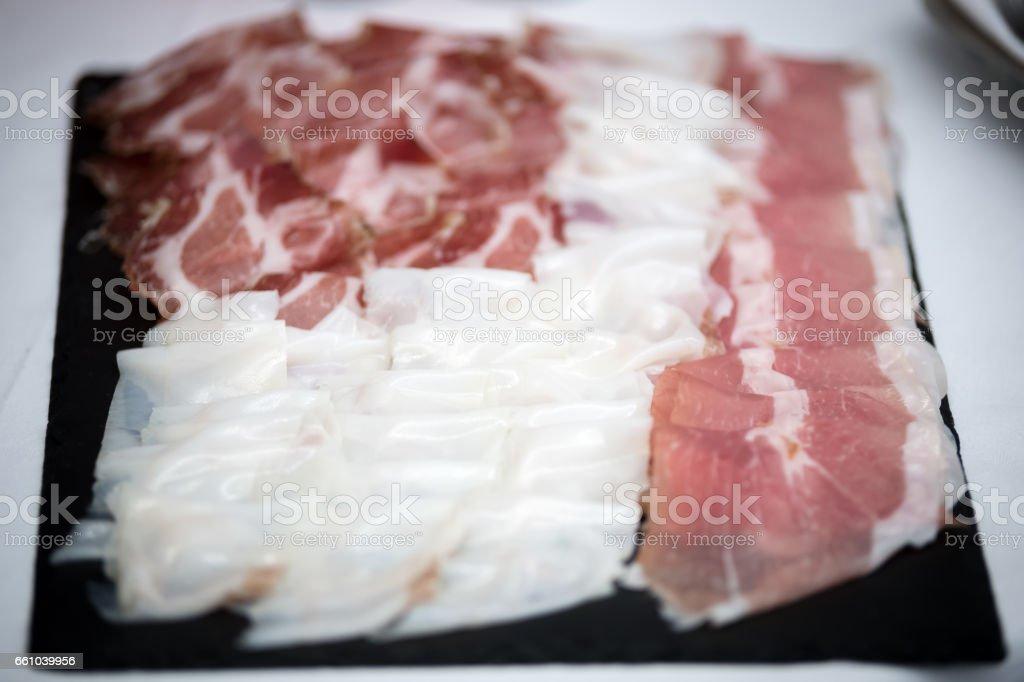 A dish full of italian sliced ham stock photo