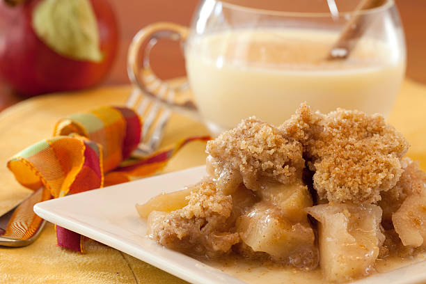 Dish Of Apple Crisp with Whipped Cream Topping and Eggnog stock photo