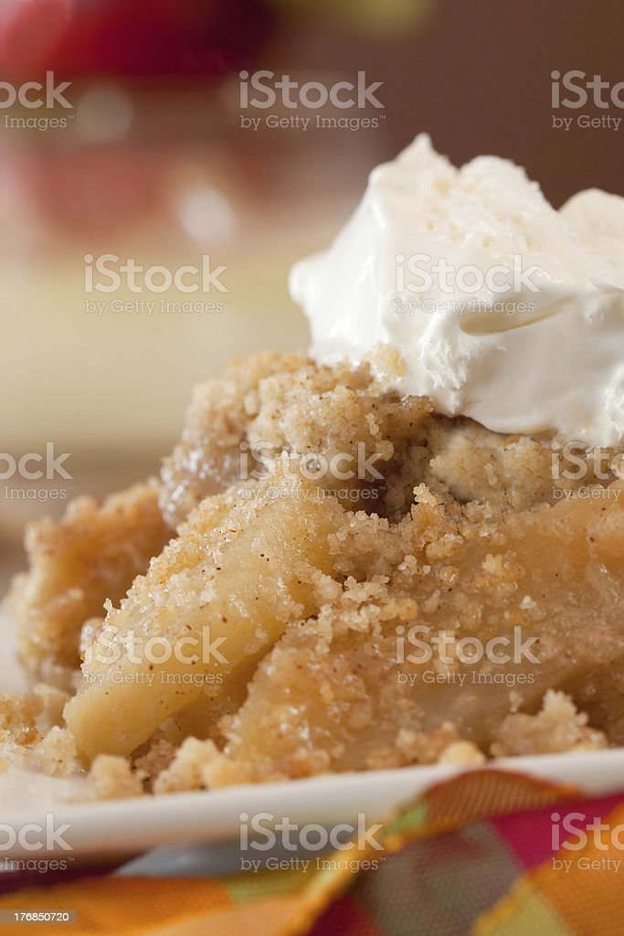 Dish Of Apple Crisp with Whipped Cream Topping stock photo