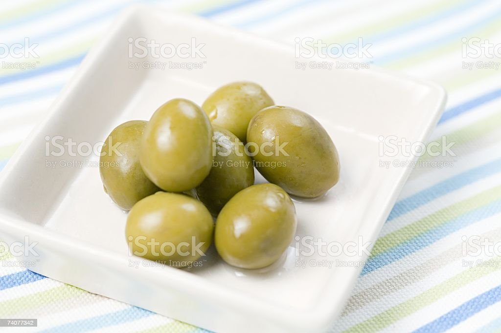 Dish of green olives royalty-free stock photo
