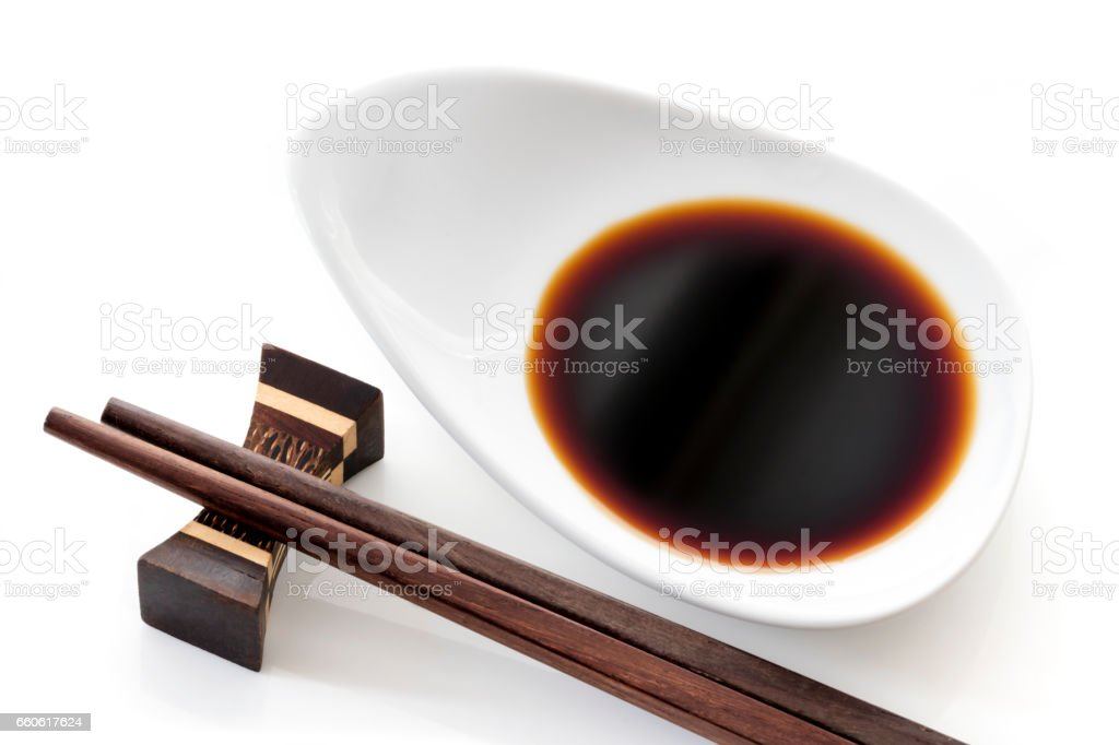 Dish of Soy Sauce with Chopsticks over White royalty-free stock photo