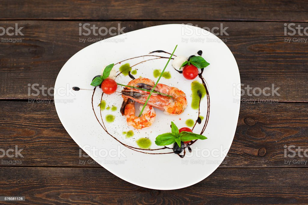 Dish of tasty grilled shrimps flat lay, copyspace stock photo