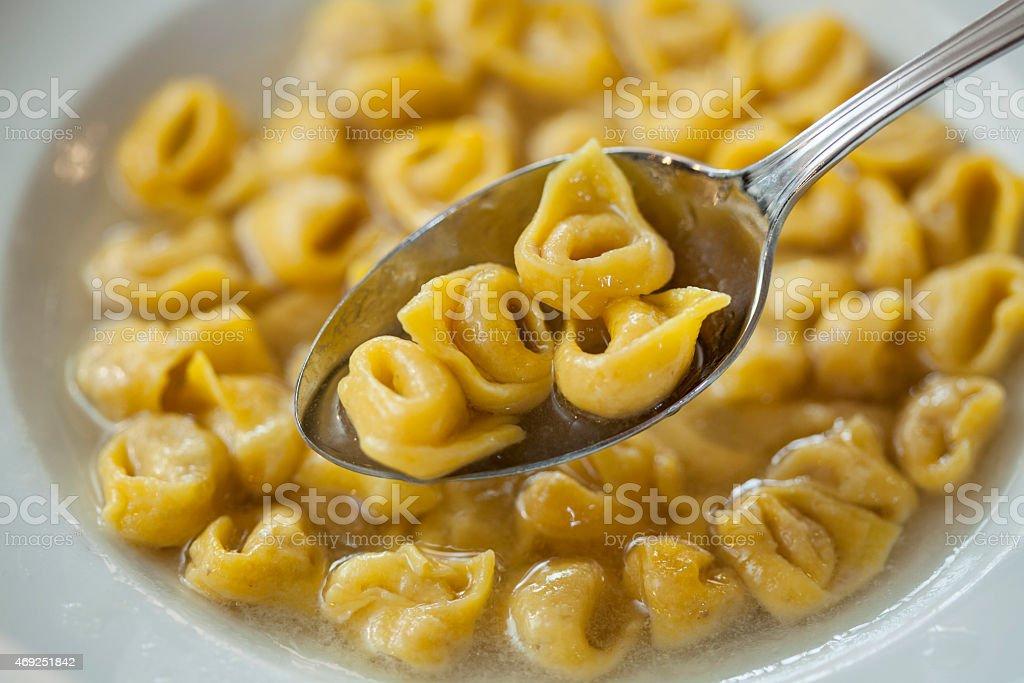 Dish of Tortellini in meat broth stock photo