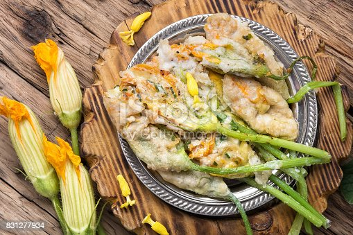 Edible zucchini flower stuffed with soft cheese with herb