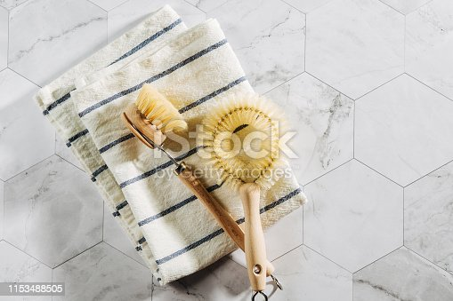 1169442284 istock photo Dish washing brushes. Eco friendly.. Zero waste concept. Plastic free. Flat lay, top view 1153488505