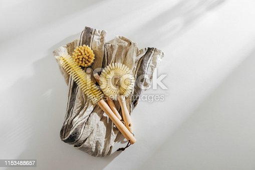 1169442284 istock photo Dish washing brushes on white background. Zero waste concept. Plastic free. Flat lay, top view 1153488657