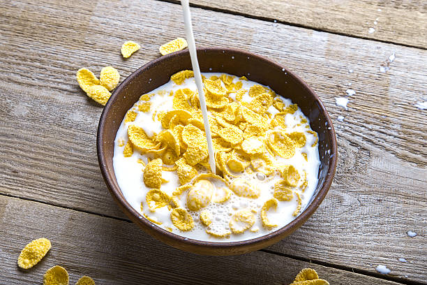 Royalty free soggy cereal bowl pictures images and stock photos dish with flakes pouring milk stock photo ccuart Gallery