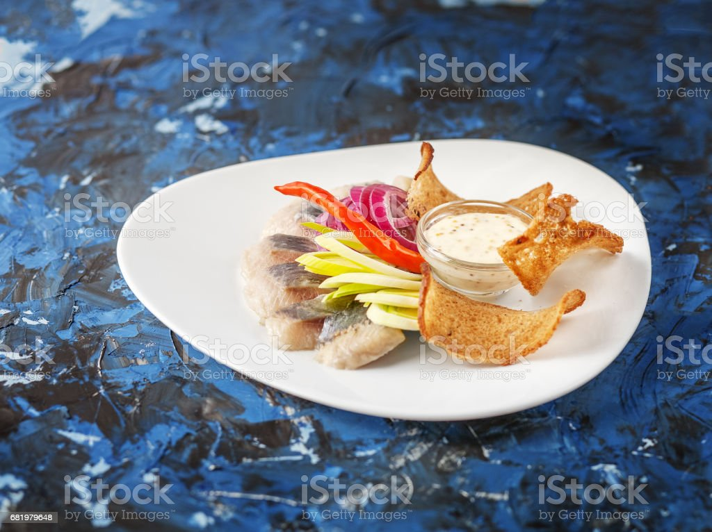 Dish with herring on a white plate.  The concept of food, restaurant, banquet stock photo