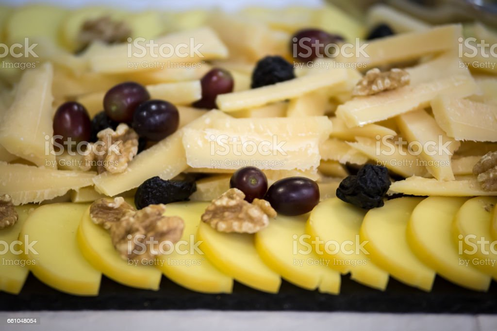 Dish with parmesan and fruit royalty-free stock photo