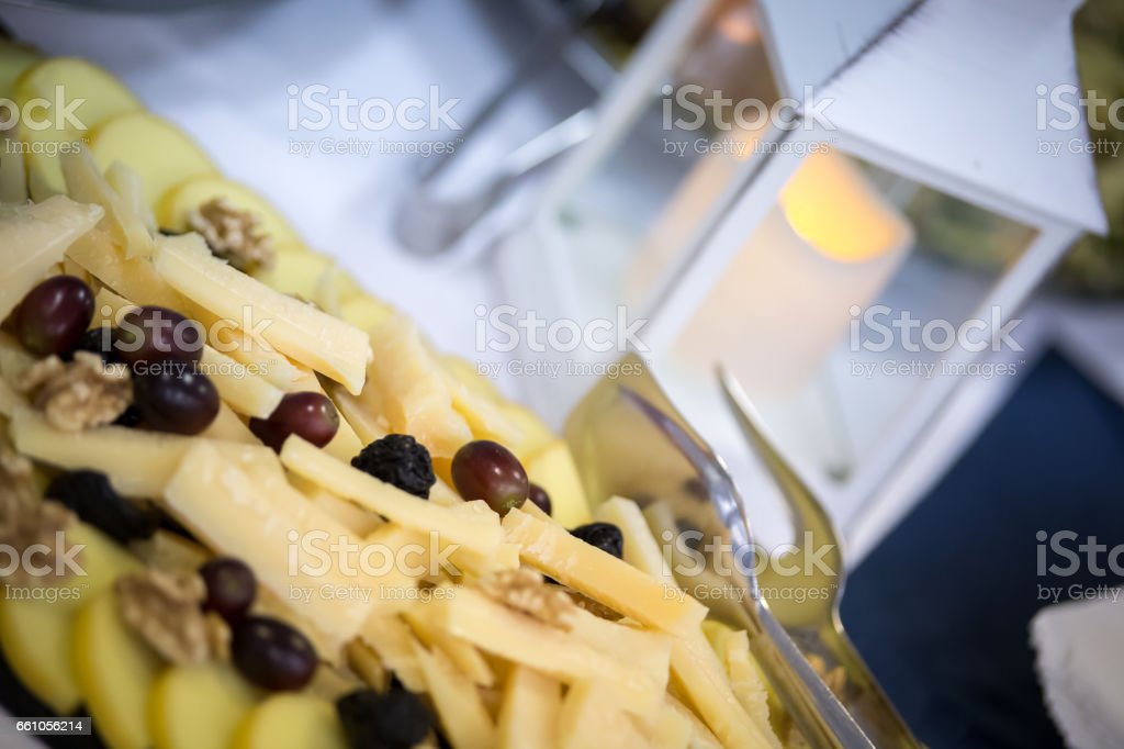 Dish with parmesan and fruit stock photo