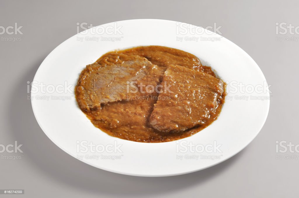 Dish with portion of braised meat stock photo