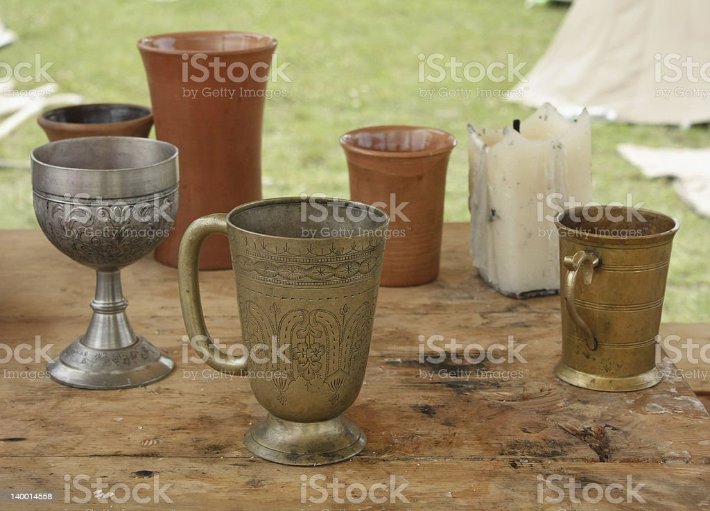 Dishes 13 th century on a wooden table royalty-free stock photo