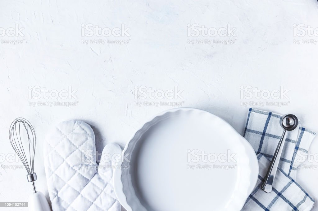 dishes and kitchen accessories for baking on the Kitchen table on a...