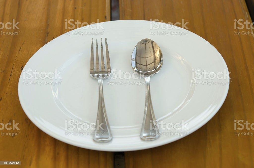 Dishes and spoon. royalty-free stock photo