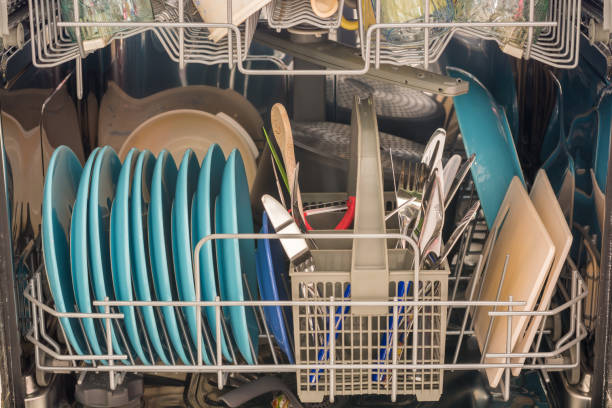 dishes filled with dishes as a helper in the household - commercial dishwasher stock photos and pictures