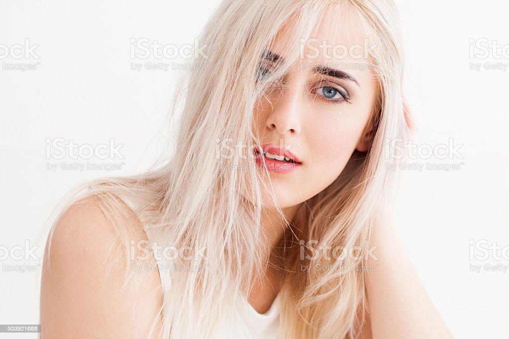 disheveled blonde calmly and trustingly looks stock photo