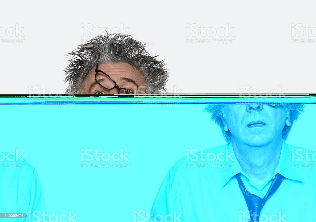 Disheveled man with glasses and loose tie stock photo