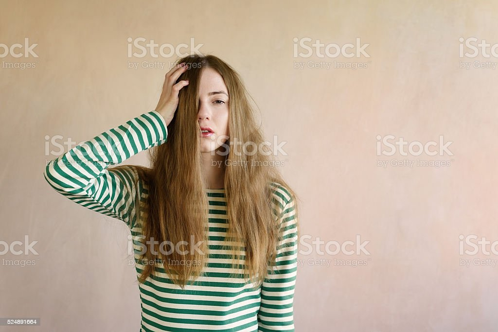 Dishevelled woman in a striped vest stock photo
