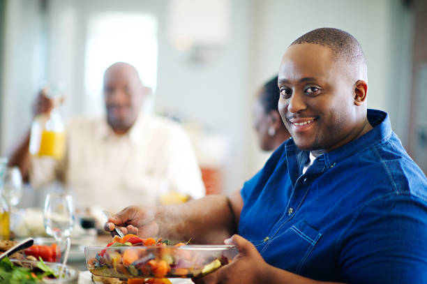 dishing those vegetables looking at camera - fat nutrient stock photos and pictures