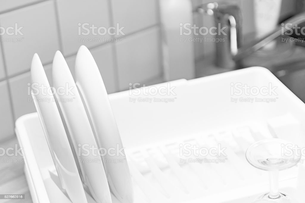 Dish-rack, plates and glass stock photo