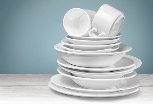 Dishware. Clean plates and cups isolated on background crockery stock pictures, royalty-free photos & images