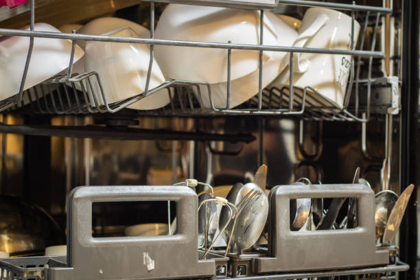 dishwasher with dirty dishes. powder, dishwashing tablet and rinse aid. washing dishes in the kitchen. - commercial dishwasher stock photos and pictures